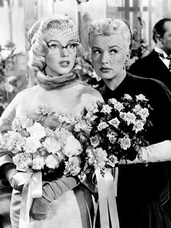 https://imgc.allpostersimages.com/img/posters/how-to-marry-a-millionaire-marilyn-monroe-betty-grable-1953_u-L-PH2V000.jpg?artPerspective=n