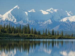 The Rugged Snow-Covered Peaks of the Alaska Range and Shore of Wonder Lake by Howard Newcomb