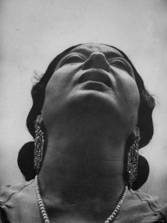 "Egyptian Actress Om Kalthoum, While Singing on Cairo's ""Voice of Arabs"" Radio Show"