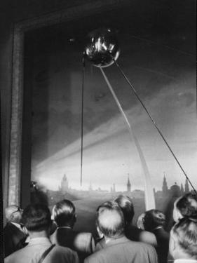 Scientists at Igy Conference Viewing Sputnik Models by Howard Sochurek