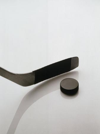 Hockey Stick and Puck by Howard Sokol