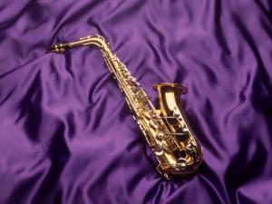 Saxophone on Purple Background by Howard Sokol