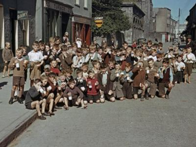 Irish School Children Eat Sweets on the Street During Recess