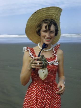 Teenage Girl Holds a Toheroa, a Marine Clam Native to New Zealand