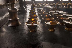 Buddhist Prayer Candles by Howie Garber