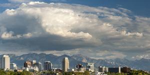 Salt Lake City below the Wasatch Mountain Range, Utah. by Howie Garber
