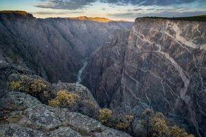 Sunrise over Gorge and Amelanchier, Gunnison River, Black Canyon National Park, Colorado. by Howie Garber
