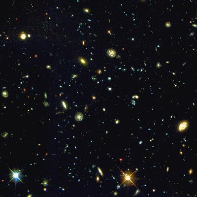 https://imgc.allpostersimages.com/img/posters/hst-deep-view-of-several-very-distant-galaxies_u-L-PZIR0B0.jpg?artPerspective=n