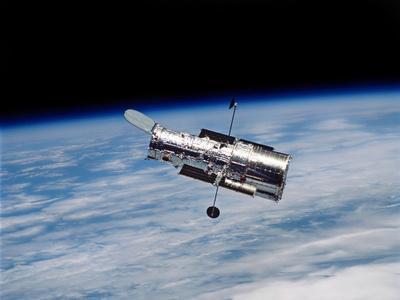 https://imgc.allpostersimages.com/img/posters/hubble-space-telescope-in-orbit-around-earth_u-L-PJ1UKD0.jpg?artPerspective=n