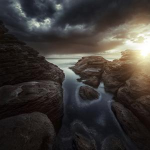 Huge Rocks on the Shore of a Sea Against Stormy Clouds, Sardinia, Italy