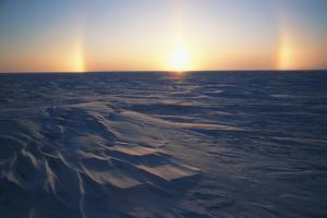 Arctic Coastal Plain, Sundog over Snowy Landscape, Alaska, USA by Hugh Rose