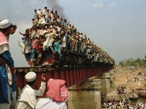Hundreds of Muslim Pilgrims Ride on a Train Passing on a Bridge at Gazipur