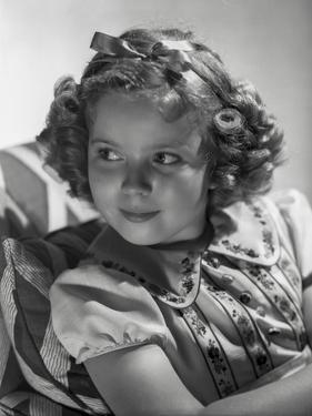 Shirley Temple wearing a Dress with Matching Hair Band by Hurrell