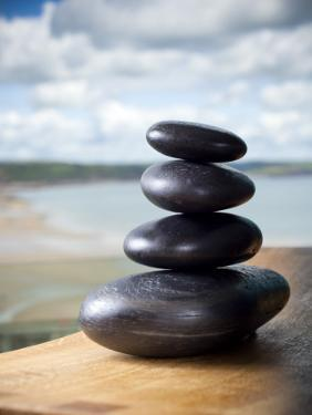 Hot Stones Spa Treatment at St. Brides Hotel and Spa with Saundersfoot Beach in Background by Huw Jones