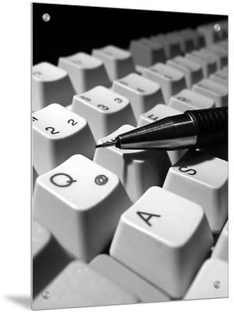 Mechanical Pencil on Computer Keyboard, Close-Up