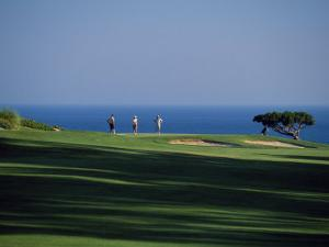 Golfers Play on the Championship Course, Algarve, Portugal by Ian Aitken