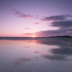 Sunset Reflected in Wet Sand and Sea on Crackington Haven Beach, Cornwall, England, UK, Europe by Ian Egner