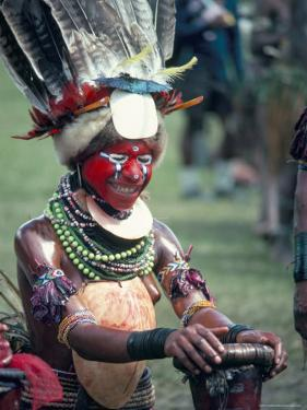 Traditional Facial Decoration and Head Dress of Feathers, Papua New Guinea by Ian Griffiths