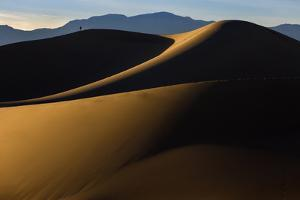 Death Valley NP, CA: Mequite Sand Dunes Near Stovepipe Wells, Hikers Along The 100 Foot Tall Dunes by Ian Shive