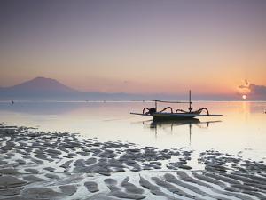 Boat on Sanur Beach at Dawn, Bali, Indonesia by Ian Trower