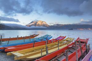 Boats on Lugu Lake at dawn, Yunnan, China by Ian Trower