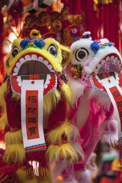 Chinese Lion Decorations at Fa Yuen Street Market, Mongkok, Kowloon, Hong Kong by Ian Trower