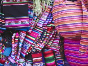 Colourful Bags and Scarves in Witches' Market, La Paz, Bolivia by Ian Trower