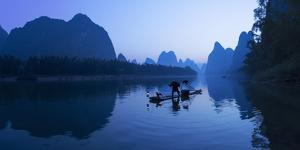 Cormorant Fisherman on Li River at Dawn, Xingping, Yangshuo, Guangxi, China by Ian Trower