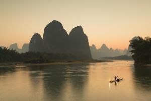 Cormorant Fisherman on Li River at Dusk, Xingping, Yangshuo, Guangxi, China by Ian Trower