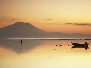 Fisherman Standing in Sea with Mount Agung in the Background, Sanur, Bali, Indonesia by Ian Trower
