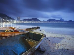 Fishing Boats on Copacabana Beach at Dusk, Rio De Janeiro, Brazil by Ian Trower