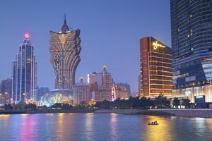 Grand Lisboa and Wynn Hotel and Casino at Dusk, Macau, China, Asia by Ian Trower