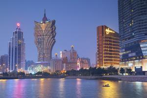 Grand Lisboa and Wynn Hotel and Casino at Dusk, Macau, China, Asia by Ian Trower