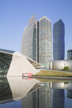 Guangzhou Opera House and Skyscrapers in Zhujiang New Town, Tian He, Guangzhou, Guangdong, China by Ian Trower