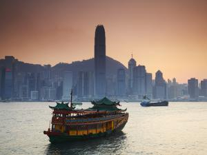Hong Kong Island Skyline and Tourist Boat Victoria Harbour, Hong Kong, China by Ian Trower