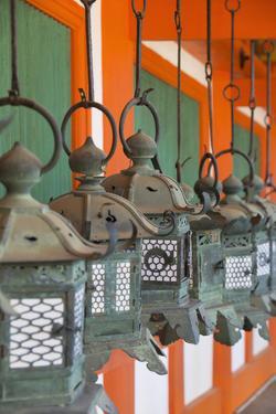 Lanterns at Kasuga Taisha Shrine (Unesco World Heritage Site) at Dusk, Nara, Kansai, Japan by Ian Trower