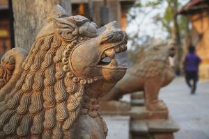 Lion Statues Outside Gorakhnath Temple at Pashupatinath Temple by Ian Trower