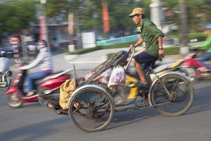 Man Riding Cyclo, Hue, Thua Thien-Hue, Vietnam, Indochina, Southeast Asia, Asia by Ian Trower