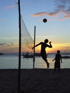 People Playing Volley Ball on White Beach at Sunset, Boracay, Philippines by Ian Trower