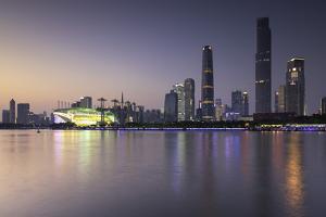 Skyline of Tianhe at dusk, Guangzhou, Guangdong, China, Asia by Ian Trower