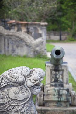 Statue and Cannon in Forbidden Purple City in Citadel, Hue, Thua Thien-Hue, Vietnam, Indochina by Ian Trower