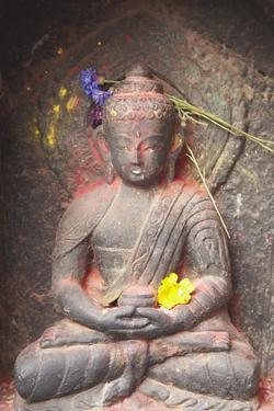 Statue at Swayambhunath Stupa, UNESCO World Heritage Site, Kathmandu, Nepal, Asia by Ian Trower