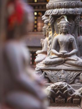 Statues at Swayambhunath Stupa (UNESCO World Heritage Site), Kathmandu, Nepal by Ian Trower