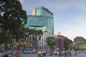 Traffic Passing Diamond Plaza, Ho Chi Minh City, Vietnam, Indochina, Southeast Asia, Asia by Ian Trower