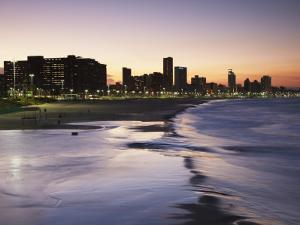 View of City Skyline and Beachfront at Sunset, Durban, Kwazulu-Natal, South Africa by Ian Trower