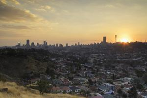 View of skyline at sunset, Johannesburg, Gauteng, South Africa, Africa by Ian Trower