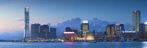 View of Tsim Sha Tsui Skyline at Dusk, Hong Kong, China by Ian Trower