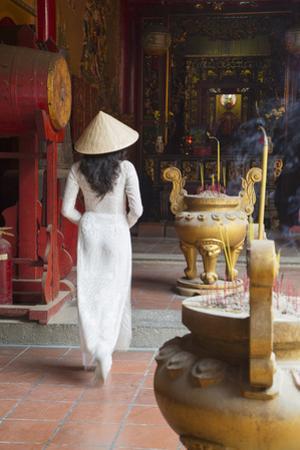 Woman Wearing Ao Dai Dress at Ha Chuong Hoi Quan Pagoda, Cholon, Ho Chi Minh City, Vietnam
