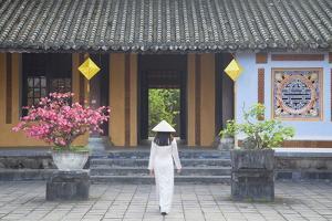 Woman Wearing Ao Dai Dress at Left House Inside Citadel, Hue, Thua Thien-Hue, Vietnam, Indochina by Ian Trower