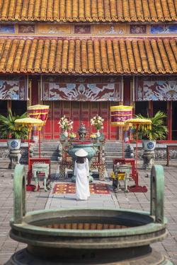 Woman Wearing Ao Dai Dress at Mieu Temple Inside Citadel, Hue, Thua Thien-Hue, Vietnam, Indochina by Ian Trower